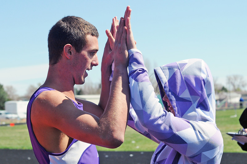 Mountain View High School senior Josh Dyekman, left, is congratulated by freshman Nicole Goddard after winning the high jump Friday, April 22, 2011 during the R2-J Invitational at the Loveland High School track.