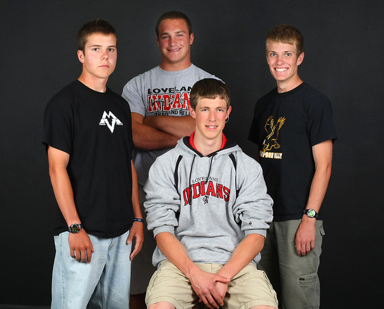 Loveland's All-Area track and field team are, from left, Mountain View's Brennan Stine, Loveland's Callen Hecker, Thompson Valley's Ben Williamson and sitting is Loveland's Casey Riggs.