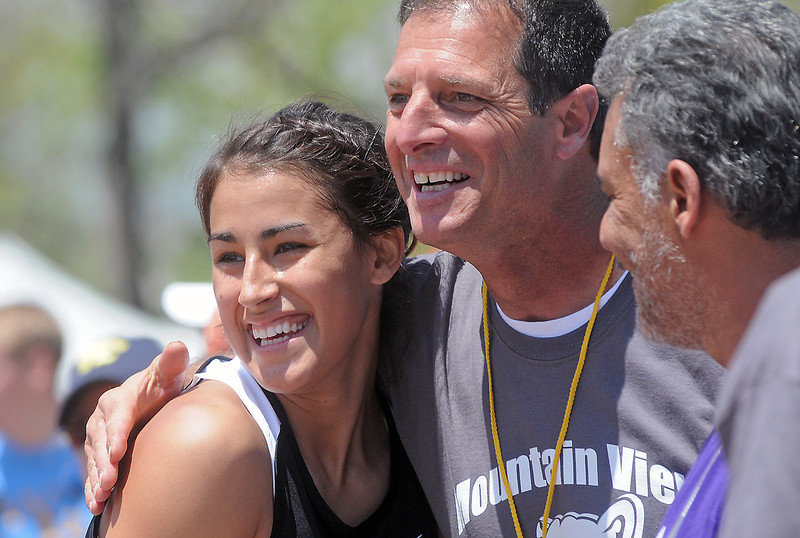 Mountain View High School senior Amy Medina is congratulated by her high-jump coach, Gary Luster, center, and father, Jose Medina, after she cleared 5 feet, 7 inches to win the high jump event Thursday during the Class 4A State Track and Field Championships at Jeffco Stadium in Lakewood.