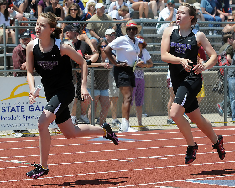 Mountain View High School freshman Moriah Zachary, left, sprints away from teammate Allison Lenart after exchanging the baton while during the 800-meter relay at the Class 4A State Track and Field Championships on Friday, May 21, 2010 at Jeffco Stadium in Lakewood.