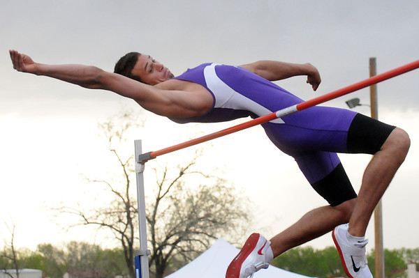 Mountain View High School's Josh Dyekman clears the bar at 6 feet, 4 inches for a new school record while competing in the high jump Tuesday during the Northern Conference Track and Field Championships at Broomfield High School.