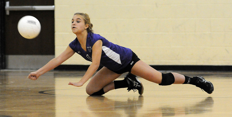 Mountain View High School freshman Rosie Cloutier dives to return a Thompson Valley High School serve during the first game. Thompson Valley took Tuesday night's home match in three games.
