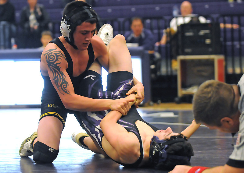 Thompson Valley High School junior Aaron Trowbridge, left, wrestles against Mountain View's Austin Anaya during the 112-pound match of their dual meet Thursday at MVHS. Trowbridge won in the second period by technical fall, 15-0.