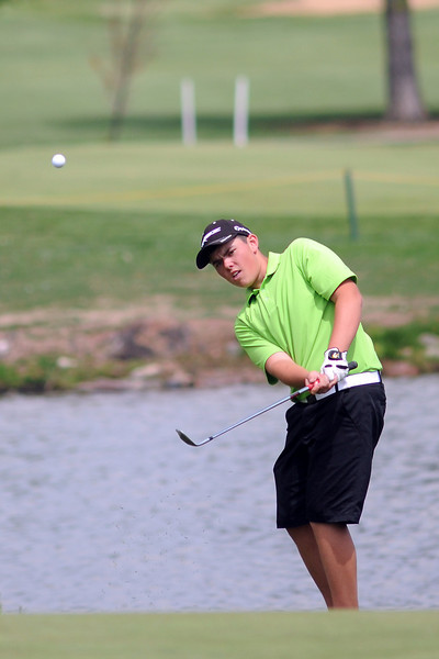 Evan Buchalski, 16, chips onto the No. 7 green while competing in the Junior Optimist Golf Tournament on Monday, June 3, 2013 at The Olde Course at Loveland.
