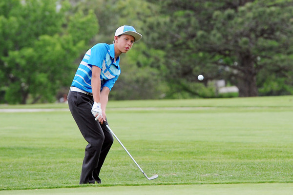 Harrison Turner, 13, chips onto the No. 9 green while playing in the Junior Optimist Golf Tournament on Monday, June 3, 2013 at The Olde Course at Loveland.