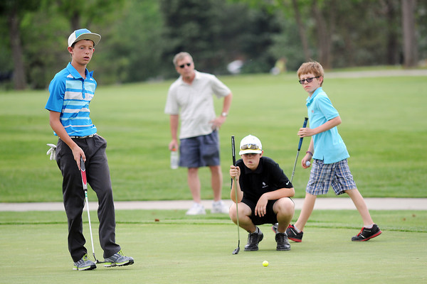 Harrison Turner, 13, left, Chase Corlett, 13, and Elliott Gitt, 10, on the No. 9 green while competing in the Junior Optimist Golf Tournament on Monday, June 3, 2013 at The Olde Course at Loveland.