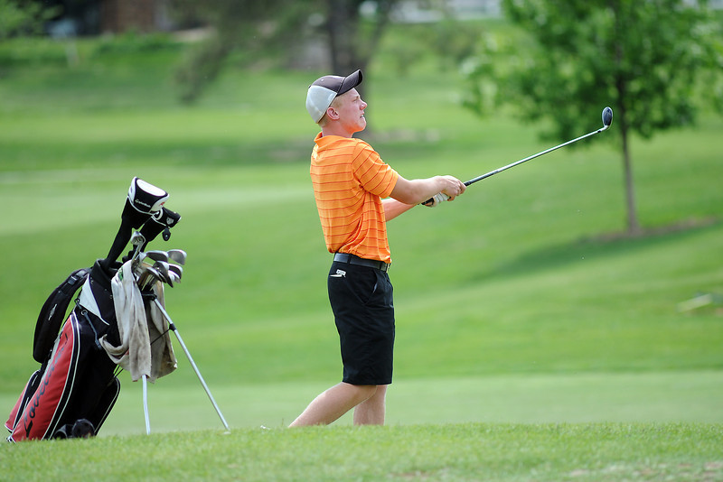 Cole Bundy watches his approach shot on No. 7 while competing in the Junior Optimist Golf Tournament on Monday, June 3, 2013 at The Olde Course at Loveland.