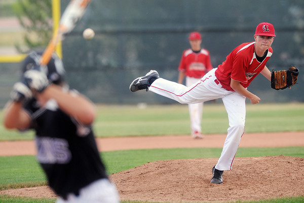 Davidson Chevrolet's Micah Dozier throws a pitch in the bottom of the second inning of a game against Johnson's Corner on Friday, June 21, 2013 at Brock Field.