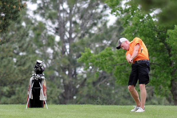 Cole Bundy, 17, hits his second shot on No. 5 while competing in the Junior Optimist Golf Tournament on Monday, June 3, 2013 at The Olde Course at Loveland.