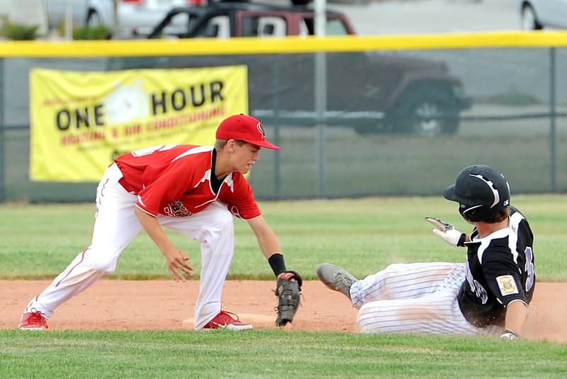 Davidson Chevrolet shortstop Ayden Eberhardt tags out Johnson's Corner baserunner Hunter Porterfield on a steal attempt in the bottom of the second inning of their game on Friday, June 21, 2013 at Brock Field.