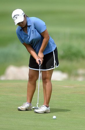Loveland High School's Raquell Castillo putts on the seventh hole of The Olde Course golf course, Monday afternoon, in Loveland, Colo.