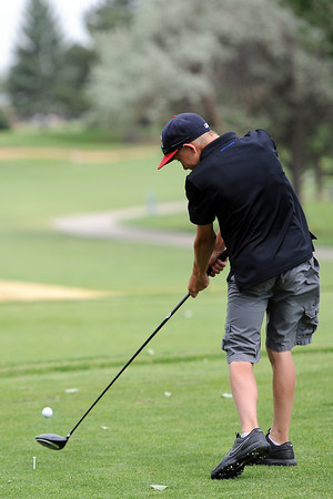 Jack Hummel, 13, hits his drive off the No. 9 tee box during the Junior Optimist Golf Tournament on Monday, June 3, 2013 at The Olde Course at Loveland.