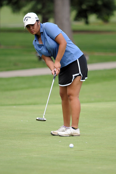 Raquell Castillo watches her putt on No. 8 while competing in the Junior Optimist Golf Tournament on Monday, June 3, 2013 at The Olde Course at Loveland.