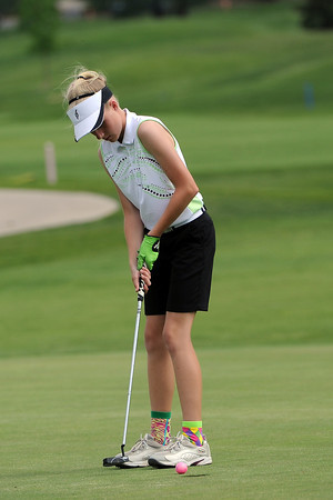 Lauren Lehigh, 12, taps in her putt on No. 8 while playing in the Junior Optimist Golf Tournament on Monday, June 3, 2013 at The Olde Course at Loveland.