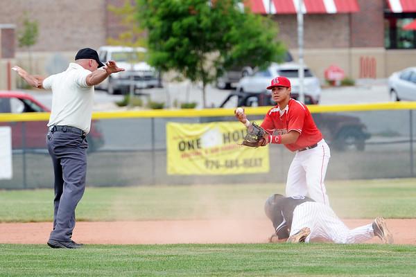 Johnson's Corner's [number 8] against Davidson Chevrolet second baseman [number 6] on Friday, June 21, 2013 at Brock Field.