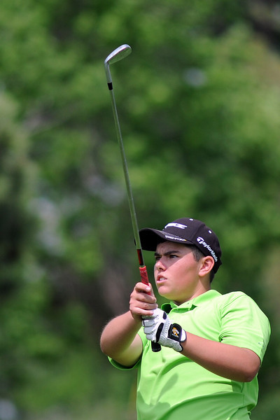 Evan Buchalski, 16, watches his drive off the No. 8 tee box while competing in the Junior Optimist Golf Tournament on Monday, June 3, 2013 at The Olde Course at Loveland.