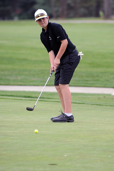 Chase Corlett, 13, watches his putt on No. 9 while competing in the Junior Optimist Golf Tournament on Monday, June 3, 2013 at The Olde Course at Loveland.