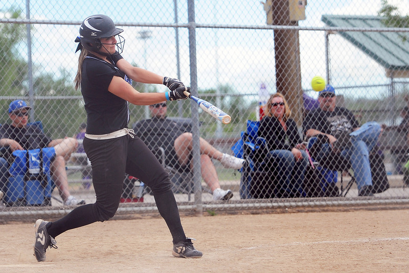 Loveland Rage's Holly Posegate hits a single in a game against the Aurora Twisters during the Rocky Mountain College Showcase on Saturday, June 1, 2013 at the Barnes Softball Complex.