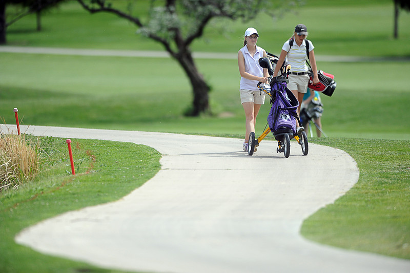 Mountain View High School's Kelsey Greiner, left, and Loveland High School's Kelsey Petersen walk to the green of hole six on The Olde Course golf course, Monday afternoon in Loveland, Colo.