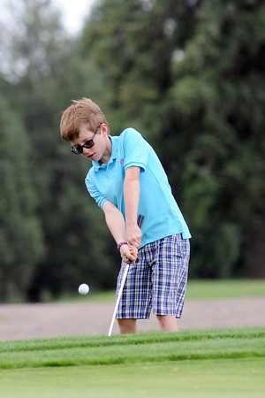 Elliott Gitt, 10, chips onto the No. 9 green while competing in the Junior Optimist Golf Tournament on Monday, June 3, 2013 at The Olde Course at Loveland.