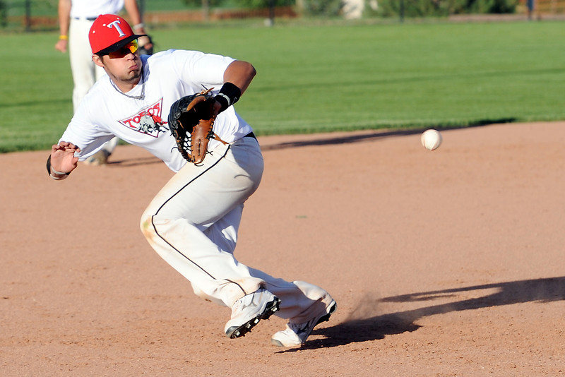 Northern Colorado Toros third  baseman Josh Karlin tracks down a ground ball hit his way during practice together Thursday, May 30, 2013 at Nelson Farm Park in Johnstown, Colo.