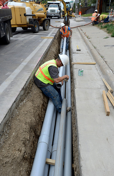 0912 NWS Construction-js.jpg Ezra Howes, front, and Mac Thomas, both with GE Construction, work to lay conduit for power lines Tuesday south of 37th Street and Taft Avenue in Loveland.