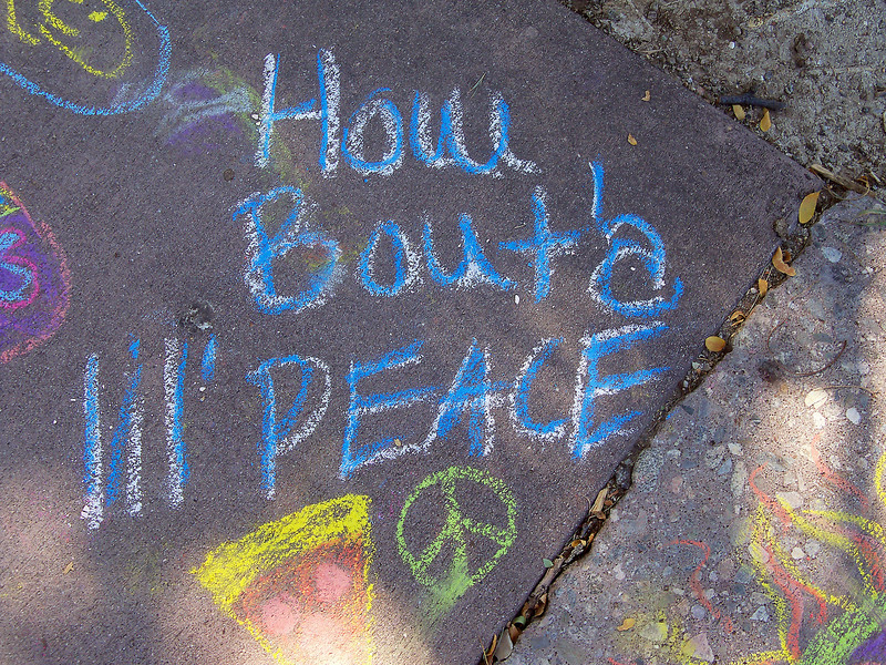 The chalk drawing is one of dozens in the Chalk 4 PeaceÊareaÊatÊLoveland Civic Center Park duringÊPeace in the Park onÊSaturday.