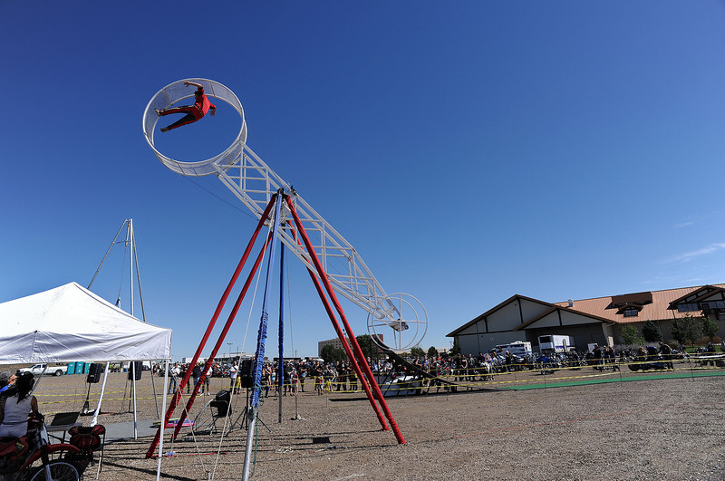 "Cyrus Nock, 14, a member of the Nerveless Nocks, performs on the ""Wheel of Death"" during the Thunder of the Rockies event on Sunday. Nock represents a 9th generation of circus performers for the family."