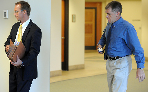 Former Loveland Police officer Rod Bretches, right, and his attorney Derek Samuelson  enter a courtroom Thursday at the Lairmer County Justice Center in Fort Collins. A possible disposition hearing had been scheduled and has been continued until mid October.