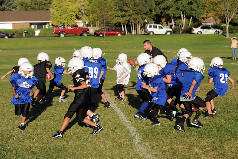 Youngsters on the Games Ahoy youth football team practice together on Wednesday, Aug. 29, 2012 near Loveland High School.