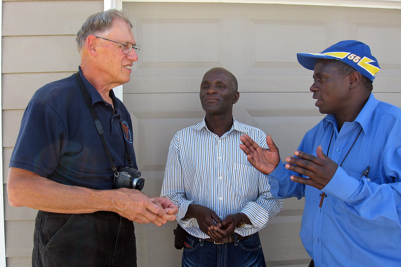 Mike Eastman, left, shares the concept of the Habitat for Humanity home-building program with Pastor John Chisumkha, right, and Richard Ziba, of Malawi, Africa. The Malawi visitors were amazed at the American programs in place to help less fortunate families.