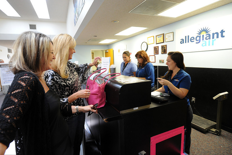 Dani Bisetti, left, and Andrea Hall check in for their flight Friday, Sept. 7, 2012 at Allegiant Air's ticket counter at the Fort Collins/Loveland Municipal Airport.