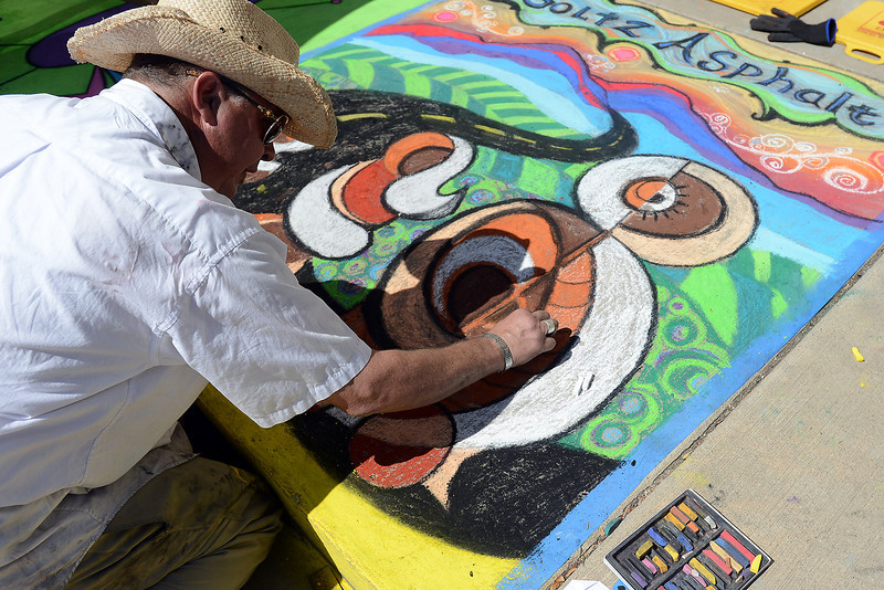 Jade Windell works on a chalk drawing on the sidewalk during Pastels on Fifth on Saturday, Sept. 8, 2012 in downtown Loveland.