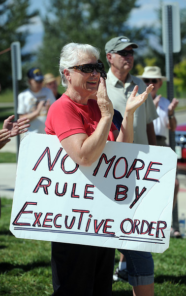Carol Huffman of Loveland cheers as she listens to former congressman Bob Beauprez speak at the Loveland Sports Park as part of the Obama's Failing Agenda Bus Tour orgainized by Americans for Prosperity.