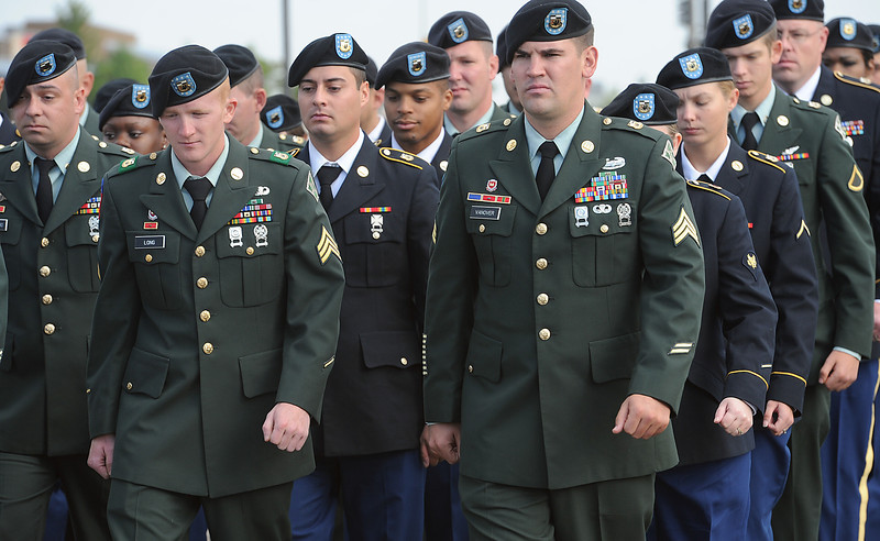 Soldiers from Staff Sgt. Christopher Birdwell's battalion march into the church Friday for his memorial service in Loveland.