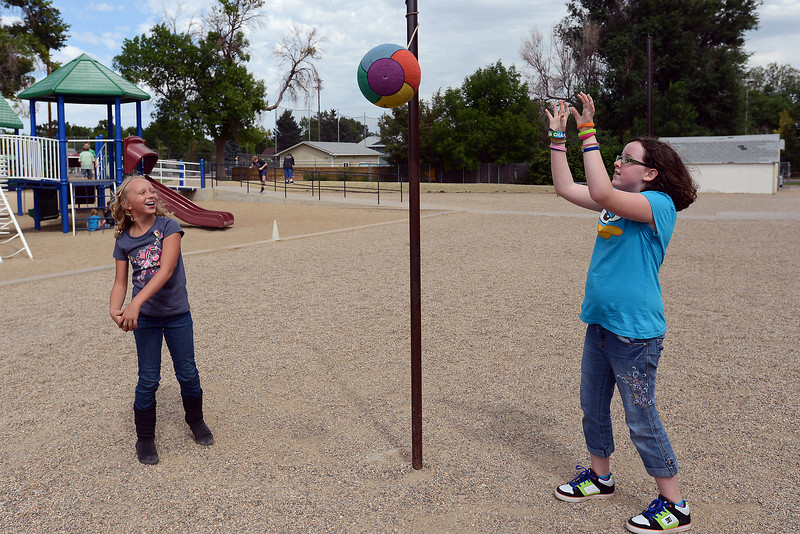 Stansberry Elementary School fifth-graders Breanna Martin, 10, right, and Hannah French, 10, play a game of tetherball together during recess at the school on Thursday, Aug. 30, 2012.