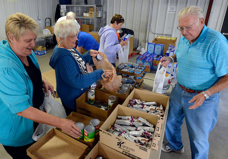 Loveland Rotary Club memebers and friends fill food packs Wednesday for more than 200 schoolkids for the Kids Pak program, which provides meals for students over the weekends to help alleviate hunger. From left are Corinne Carrigan, Claire Grinager, Fran Phillips and Bob Lebsack.