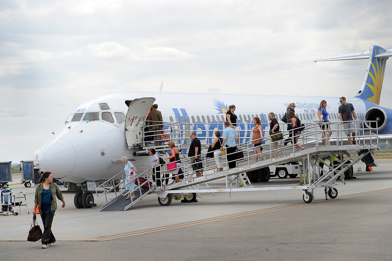 Passengers make their way off an Allegiant Air jet on Friday, Sept. 7, 2012 at the Fort Collins/Loveland Municipal Airport after arriving from Las Vegas.