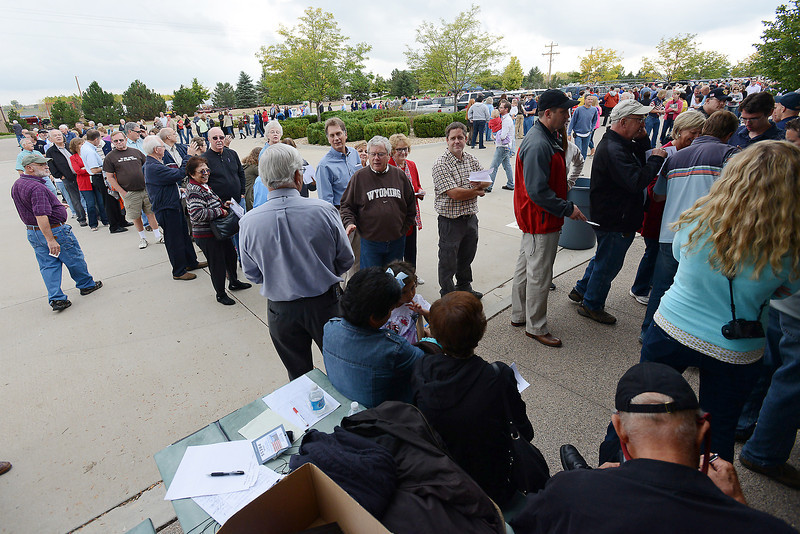 People line up outside Walker Manufacturing in Fort Collins prior to a visit by Republican vice-presidential candidate Paul Ryan on Wednesday, Sept. 26, 2012 while campaigning in the state.
