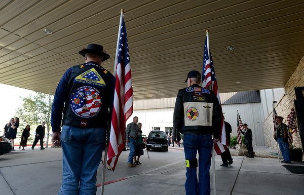 Patriot Guard Riders line the entrance to Resurrection Fellowship Church Friday as folks enter for Staff Sgt. Christopher Birdwell's memorial service.
