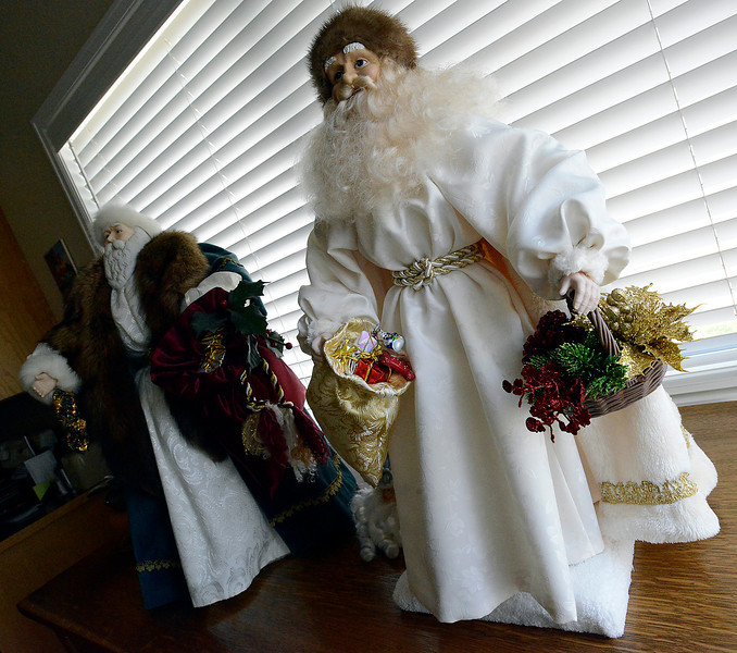 A couple of Bonnie Fahrenbruch's finished St. Nick doll creations at her Loveland home Friday.