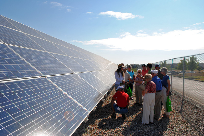 Paul Spencer, founder and chief executive officer of Clean Energy Collective, describes solar panels to several residents who bought into the Poudre Valley Rural Electric Association's solar farm, the first of its kind in Northern Colorado.