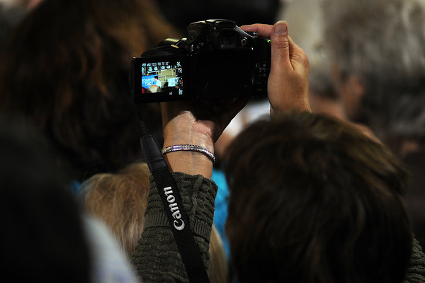 An attendee takes a picture of Republican vice-presidential candidate Paul Ryan during a campaign rally on Wednesday, Sept. 26, 2012 at Walker Manufacturing in Fort Collins.