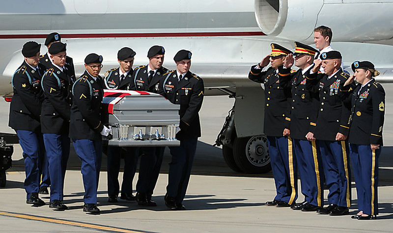 U.S. Army Honor Guard soldiers carry the casket of U.S. Army Sgt. Christopher Birdwell from an airplane to a hearse at the Fort Collins-Loveland Municipal Airport on Wednesday, August 5, 2012. Sgt. Birdwell was killed in action in Afghanistan on August 27, 2012.