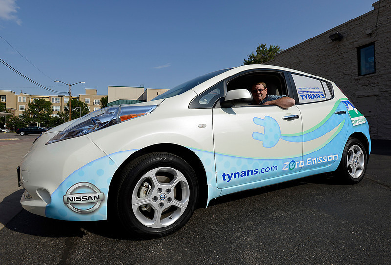 Steve Kibler, fleet manager for the City of Loveland, shows off 1 of 2 new Nissan Leaf all electric cars Monday that are new to the city's fleet.