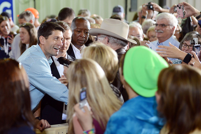 Republican vice-presidential candidate Paul Ryan, left,  greets attendees after speaking at a campaign rally on Wednesday, Sept. 26, 2012 at Walker Manufacturing in Fort Collins.
