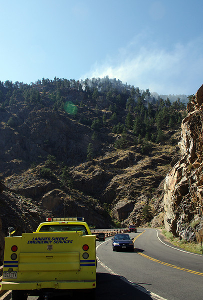 Traffic continues to proceed Wednesday on U.S. 34 west of Loveland below a small wildland fire.