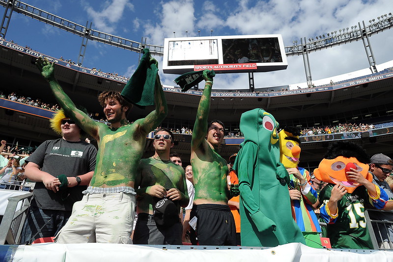Colorado State football fans, front from left, Greg Gius, Aaron Jackson, Josh Buras, Sam Fisher, Matt Peters and Nick Hunter cheer on the team during their game agaisnt Colorado on Saturday, Sept. 1, 2012 at Sports Authority Field at Mile High. The Rams defeated the Buffs, 22-17.