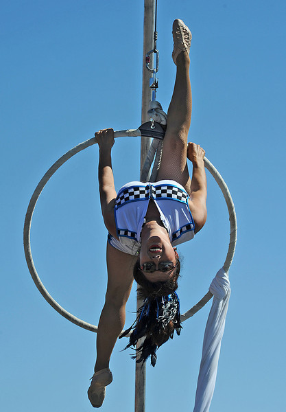 "Gladis Espa–a, a member of the Nerveless Nocks, performs on the ""Wheel of Death"" during Thunder of the Rockies on Sunday."