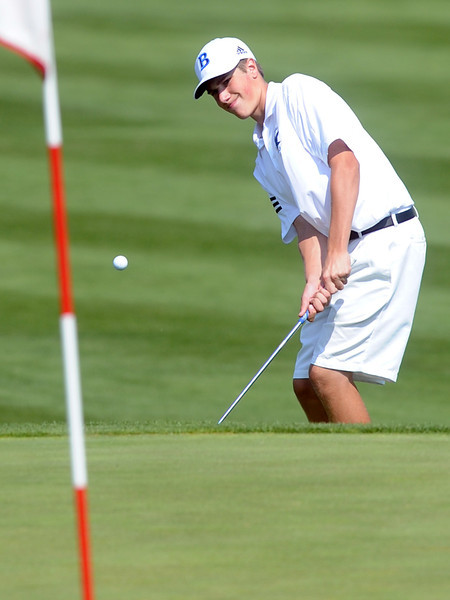 Broomfield High School's Alex Gorman chips onto the No. 17 green while competing in the Class 4A Regional Golf tournament on Wednesday, Sept. 19, 2012 at Indian Peaks Golf Course in Lafayette.